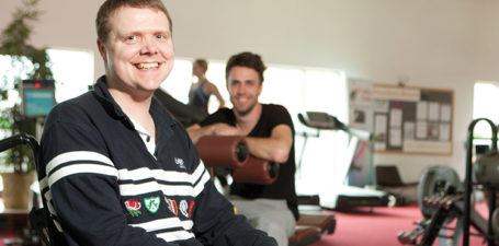 A customer in the gym with his live-in carer